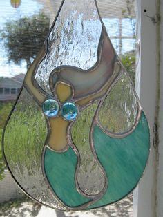 Mermaid in a teardrop. $45.00, via Etsy.