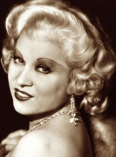 Mae West was considered scandalous in her time, but overcame censorship in the media to become a movie icon. Her style of humor isn't nearly as shocking today as it once was, but she still represents a certain sort of walk-on-the-wild-side attitude