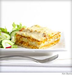 Grated butternut squash, pine nuts and sauteed leeks in a creamy white sauce are layered with sheets of whole-wheat pasta in this awesome #vegetarian squash and leek lasagna.