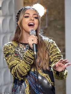 Cool: Jade wore a slouchy jumper and skirt co ord for the performance...