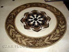 This is beautiful for the front door entry. SP18 Marble Medallion with Crema Marfil field, ID383. Check pictures of other inlays, wood and stone medallions, borders and parquet from Czar Floors.