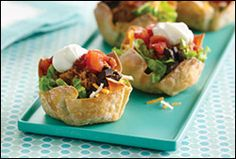 Individual taco salads served in a edibe wonton wrapped! ~perfect for an appetizer or to help with portion control.Bonus:she has a wonton weight watchers sheaprds pie recipe too!