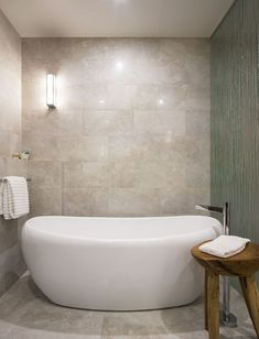 Transforming your bathroom into a peaceful retreat will provide personal sanctuary there's an inspiring ideas that can help you create a spa-like ambience. Simple Elegance, Elegant, Crystal Light Fixture, Wooden Bathtub, True Homes, Stunning Wallpapers, Wood Panel Walls, Modern Bathrooms, Home Spa
