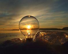 Wonderful concept.   Sunset through light bulb