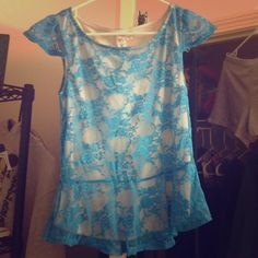 Charlotte Russe NWT peplum top Cream colored with blue overlay, great for the spring! Tops