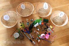 Sorting Baskets Phonics Activity - The Imagination Tree Jolly Phonics Activities, Preschool Phonics, Alphabet Phonics, Phonics Games, Alphabet Activities, Kindergarten Literacy, Preschool Activities, Early Literacy, Phase 1 Phonics