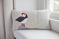 Beautiful Puffin cushion on natural linen with a mixed tweed body and red wool beak and legs. The cushion is backed with a soft grey wool, woven in Wales ( available as a throw via email) Dry Clean only. Includes a cotton covered feather pad. Applique Cushions, Sewing Pillows, Wool Applique, Fabric Crafts, Sewing Crafts, Sewing Projects, Nautical Cushions, Funky Cushions, Herringbone Fabric