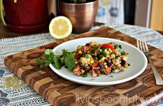 Fiesta salad made with black beans, corn, avocado and cilantro...perfect for a summer day as a salad, in a lettuce wrap, or on polenta...get the recipe on our blog!