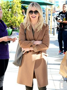 Julianne Hough, in dapper round sunnies, was all smiles after enjoying lunch with her parents! Love her festive bright red lipstick, by the way!
