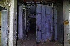 Dark Hallways and heavy doors in an abandoned slaughterhouse and meat packing plant.  Full article here: http://www.placesthatwere.com/2016/07/abandoned-slaughterhouse-and-meat.html  #abandoned #abandonedplaces #decay #abandonedbuildings #derelict #slaughterhouse #industrialdecay #urbex #urbanexploration #door #darkhallway #hallway #securitydoor #creepy #horror #dark