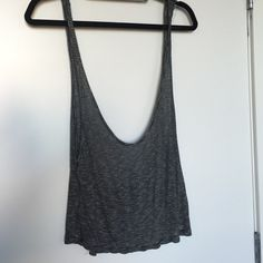 Brandy Melville tank top Black and white striped tank, loose fit- great condition! Brandy Melville Tops Camisoles