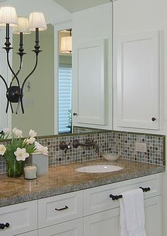 I'm sharing some good practices to go by when dealing with outlets and light switches on your kitchen backsplashes today. These are the guidelines I use when I design a kitchen and I'm kind of excited to lay it all out here in this post. White Bathroom Cabinets, Kitchen Cabinets, Outlets, Kitchen Backsplash, Master Bathroom, Kitchen Remodel, Mirror, Herringbone, Mansion
