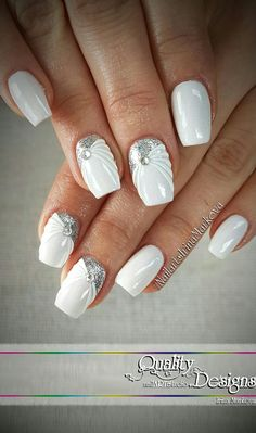 Classy white with an elegant twist— I'm not in love with the color choice combined with this look, but I do like the style