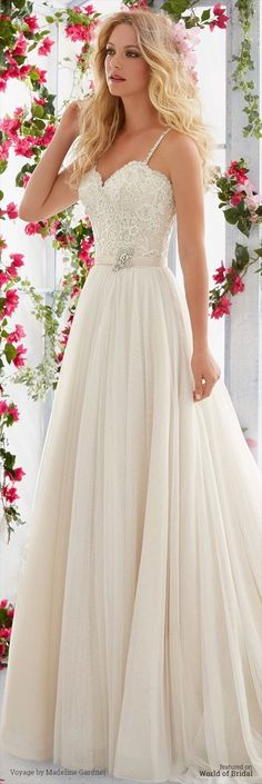 White wedding dress. Brides dream about having the most suitable wedding, but for this they need the perfect bridal gown, with the bridesmaid's dresses complimenting the brides-to-be dress. Here are a few ideas on wedding dresses.