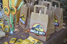 Favor bags at a Jurassic dinosaur birthday party! See more party ideas at CatchMyParty.com!