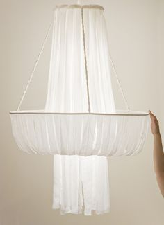 Made from cotton strips, this chandelier emits a soft, natural glow. By Judith Seng