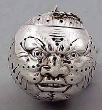 Rare Man in the Moon Tea Ball. A rare antique, sterling silver Gorham tea ball with finely pierced detailed surface and a hinged lid. 1886