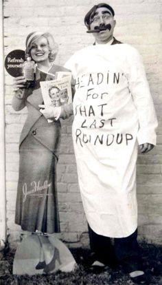 """Groucho Marx poses next to a life-sized cut-out of Jean Harlow advertising Coca-Cola in 1933. Groucho sent this to friends in Massachusetts with the greeting """"Merry Xmas to you all and the folks - Groucho Marx""""."""