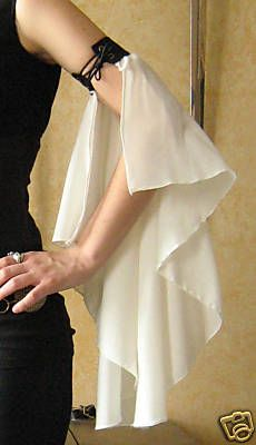 Sleeves, shortcut for flowing sleeves underneath a sleeved over-dress. Interesting, and elastic could work as well as the laceup......