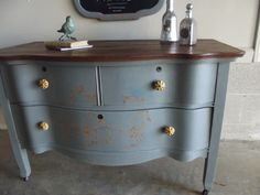 Chalk painted dresser with stenciled bird and vine