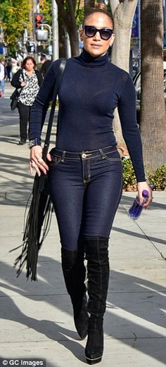 Saucily understated: Opting for a casual yet racy look, the 46-year-old chart-topping pop queen made sure all eyes were on her as she sashayed down the sidewalk in a pair of skin tight jeans and semi-sheer roll neck