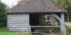 Saw-pit shed from Sheffield Park, Sussex. DISMANTLED 1977. RECONSTRUCTED 1980. This 19th-century building provides cover for a permanent saw-pit and is typical of many such buildings in villages and on estates. Inside can be seen a range of tools used in the handling and conversion of timber.