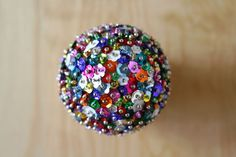DIY: Sequin Sparkles Ornament // Caught On A Whim Blog * glass flower beads or wired over glass ball ornament.