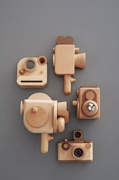 Love this adorable collection of wooden toy cameras - especially the vintage style movie camera!