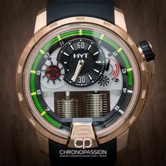 HYT H1 showing hours with the green Iiquid substance and minutes with the off centered hand at 12 o'clock. HydroMechanics.