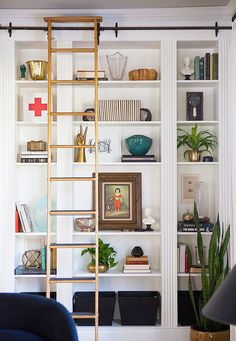 Don't you love finding IKEA hacks that are wildly functional and extremely good-looking? Kudos to this group of nine handy people changing things up with basic ikea products. Enjoy our picks for 9 Ikea Hacks. Ikea Bookcase, Built In Bookcase, Ikea Shelves, Wall Shelving, Bookshelf Ladder, White Shelves, Book Shelves, Bookshelf Styling, Floor To Ceiling Bookshelves