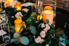 Lovely candle and greenery decor at an industrial chic wedding reception.