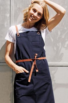 Have you met Tom? Our Tom Bib Apron has been a favourite since the day this game-changing style landed in the Cargo Crew warehouse - and with good reason! Bold details, stand-out details & quality finishes make this style an all-rounder. With the NEW Navy colourway landing this week, Tom is now available in 5 colours, and styled up or down this apron can create the perfect uniform look for any style of venue. Navy Apron | New Colour | Cafe Style | Event Planner | Barista | Summer Uniform Bib Apron, Aprons, Black Apron, Cafe Style, Apron Designs, Navy Color, Work Shirts, Barista, Striped Tee