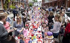 People attend a street party in central London to celebrate the Queen's Jubilee - A nation united as one family