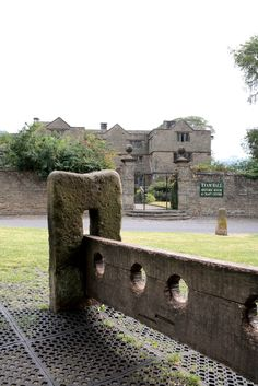 The stocks and Eyam Hall, Eyam, Peak District
