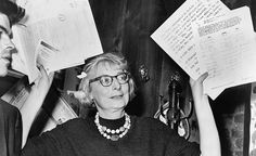 Jane Jacobs at a press conference, 1961. She would have turned 100 this month.  Photo © Phil Stanziola