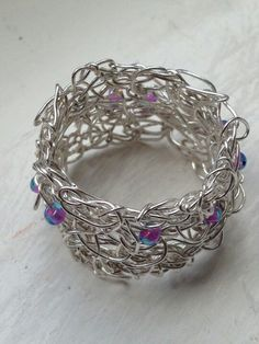 Crocheted wire ring by ribbons and rings