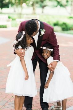The cutest flower girls ever. Photography : Shannon Moffit Photography Read More on SMP: http://www.stylemepretty.com/2016/08/18/downtown-richmond-burgundy-wedding/