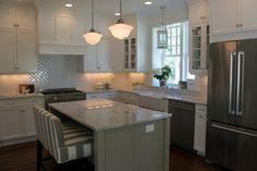 Pretty kitchen renovation.  I like the small squares set on the diagonal for the backsplash.