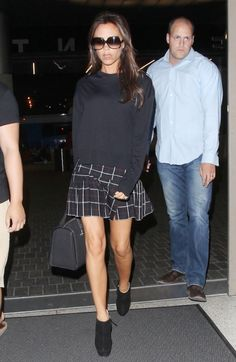 Victoria Beckham wearing Cutler and Gross 0811 Sunglasses Victoria Beckham Tote Mini in Black Buffalo Giuseppe Zanotti Suede Bootie Isabel Marant Tyme Pleated Plaid Skirt  LAX airport August 27 2013