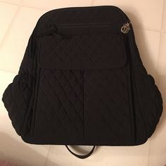 "Vera Bradley Backpack Vera Bradley Ultimate Backpack in Black. Never used. Front pocket has place for your license too. Dimensions 11 ½"" W x 14 ¾"" H x 5 ½"" D with 31 ¼"" adjustable straps, 3"" handle drop Vera Bradley Bags Backpacks"