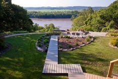The tree-lined, rolling lawn peeks out onto a gorgeous view of the Missouri River.