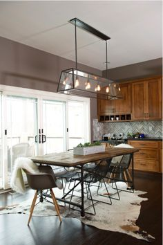 This rustic modern dining area mixes two different styles of chairs that really pull this space together nicely with a bit of mid-century flair. www.benjaminrugsandfurniture.com