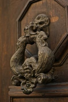 Two roosters on this old door knocker