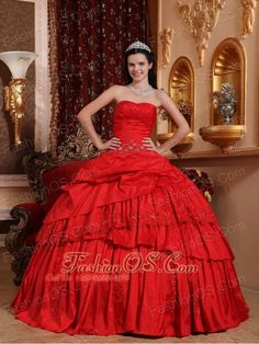 Beautiful Red Quinceanera Dress Sweetheart Taffeta Beading and Appliques Ball Gown  http://www.fashionos.com    This special red evening ball gown dress is sure to impress at your next prom or special occasion party. You'll be the belle of the ball in this glittering prom gown. A sweetheart strapless ball gown dress featuring a floral embroidered and beaded bodive withe ruched bust. The appliques flowers on the bustline. The full ball gown skirt also has an embroidered floral design.