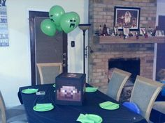 DIM Minecraft party. Creeper balloons are green balloons with electrical tape & Steve head is a spray painted box with free prints from internet.  Nailed it!