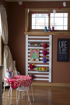 Repurposed crib rail and hanging storage containers.