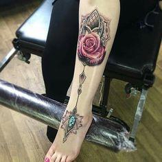 Stunning custom leg tattoo with a pink rose and a green gem, done on woman's leg. Foot Tattoos, Cute Tattoos, Beautiful Tattoos, Tatoos, Best Tattoo Designs, Tattoo Designs For Women, Ankle Tattoo Mandala, Juwel Tattoo, Underarm Tattoo