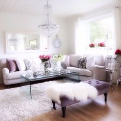 Such a beautiful living room. Wish it was mine. I love the pop of the pink roses.