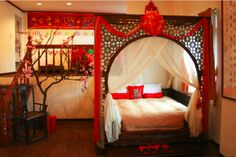In contrast to the minimal aesthetic of Japanese style, Chinese style features more rich ornamentation and deeper colors. Red is a popular color in Chinese design. Ornamentation includes traditional motifs such as dragons, pagodas, Fu dogs, phoenixes, flowering branches and chrysanthemums. Rooms and homes are organized and arranged according to the principles of Feng Shui