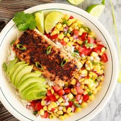 These blackened fish taco bowls with corn salsa are quickly becoming a family favourite! Spicy fish, fresh avocado, and corn salsa on rice!